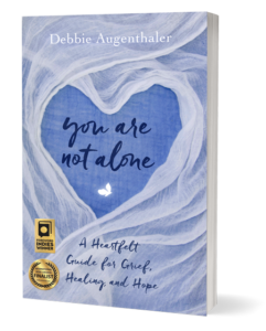 "Cover image of award winning book ""You Are Not Alone"" by Debbie Augenthaler"
